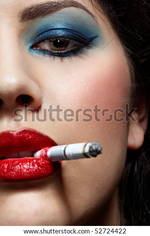close up portrait of young smoking girl - stock photo