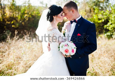 Close up portrait of young stylish weding couple - stock photo