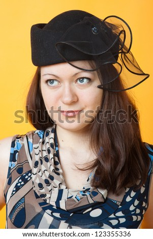 close-up portrait of young woman in a hat - stock photo
