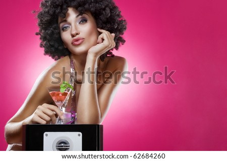Close up portrait of young woman in afro wig on color back