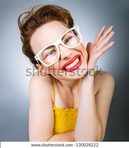Close-up portrait of young woman in funny glasses with annoyed grimace - stock photo