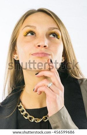 Close up portrait of young woman looking up and thinking or dreaming about something - stock photo