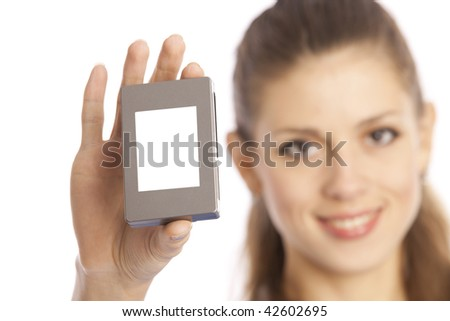 close-up portrait of young woman shows a box with copy-space. Focus to hand and a box