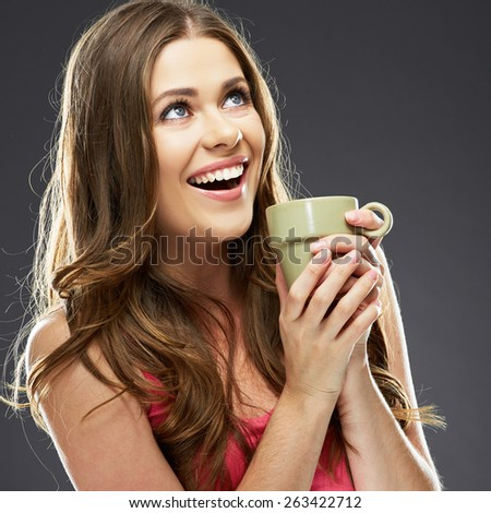 Close up portrait of young woman with coffee cup. Beautiful smiling girl.