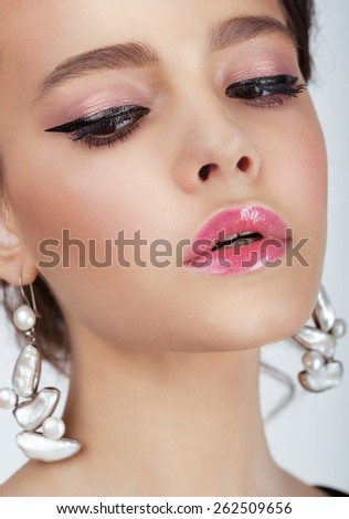 Close Up Portrait of Young WOman with Earrings - stock photo