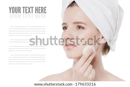 Close-up portrait of young woman with perfect health skin of face, bath towel on head and clean sponge. Isolated on white - stock photo
