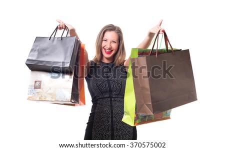 close-up portrait of young woman with red lipstick and bags from the store in the hands isolated on a white background. shopping - stock photo