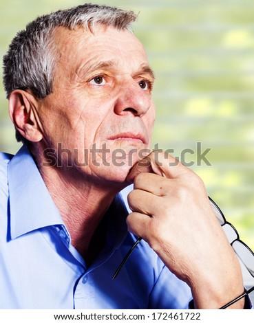 Close-up portrait os a senior man thinking about problem  - stock photo