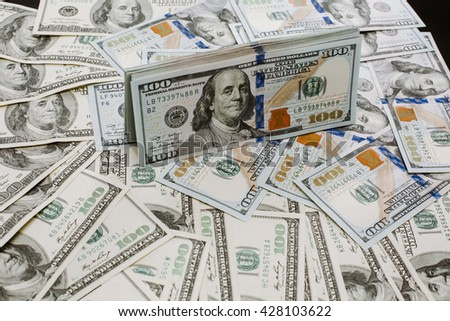 Close-up portrait photo of money. 100 dollars banknotes heap. - stock photo