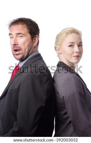 Close up portrait, shot in a studio, of two work colleagues back to back, isolated on white.  One is looking happy, the other is having a bad day at work. - stock photo