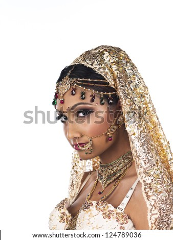 Close-up portrait shot of attractive young woman wearing bridal costume and elegant jewelry over plain white background. - stock photo