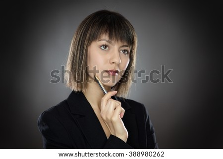 close up portrait shot of young successful business woman looking pensive. - stock photo