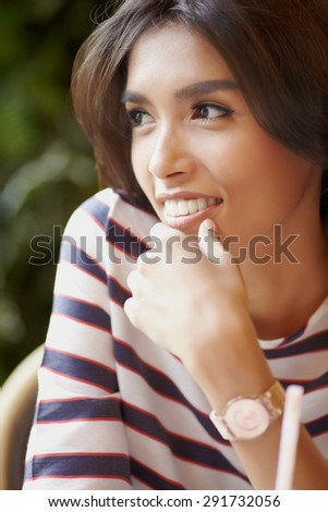 Close up portrait smiling asian model - stock photo
