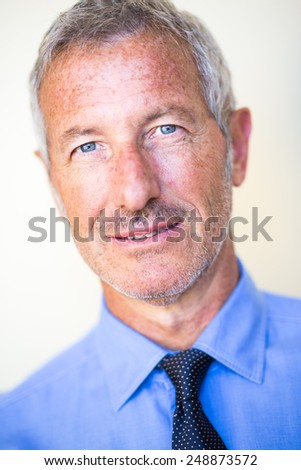 Close up portrait with shallow depth of field of a rich successful handsome businessman - stock photo