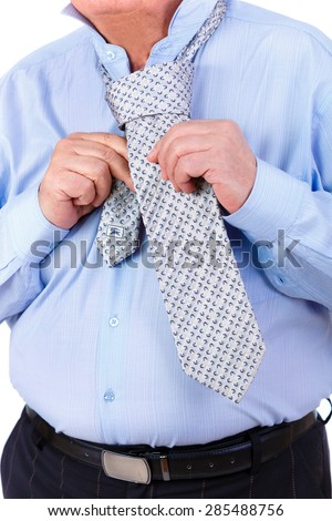Close-up portrait without face, old mature businessman ties a tie. isolated on white background.  - stock photo
