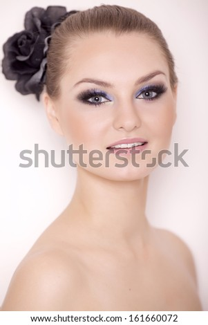 close up portrait young adult pretty woman with beautiful blond hairs and multicolor makeup isolated on white background