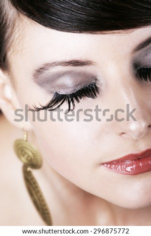 Close up Pretty Face with Elegant Makeup of a Thoughtful Young Woman with Eyes Closed - stock photo