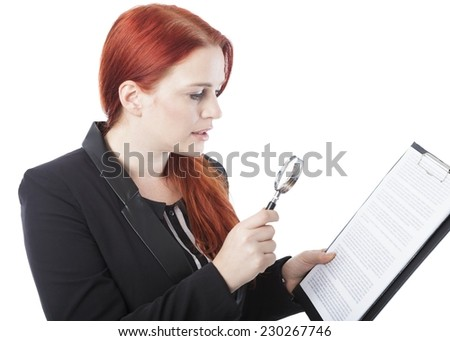 Close up Pretty Young Office Woman Reading Document on Clipboard Using Magnifying Glass. Isolated on White Background. - stock photo