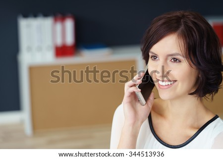 Close up Pretty Young Office Woman Talking to Someone Through Mobile Phone. - stock photo