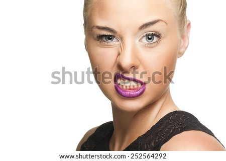 Close up Pretty Young Woman in Violet Lips Showing Wacky Face While Looking at the Camera. Isolated on White. - stock photo
