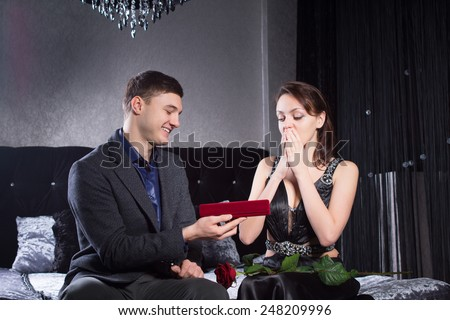 Close up Pretty Young Woman Received a Jewelry Gift From Boyfriend, Emphasizing her Surprise Reaction. - stock photo
