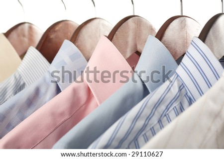 Close-up rack shirts isolated on white background - stock photo