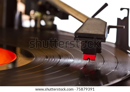 close up reading arm of turntable - stock photo