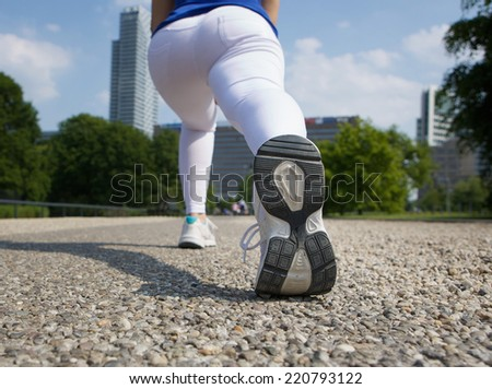 Close up rear angle of woman stretching outdoors