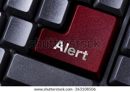 close up red enter button written Alert - stock photo