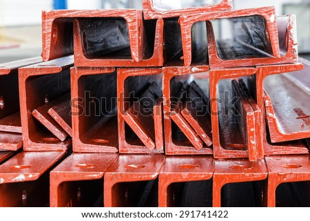 Close up red heap of U shape beam steel in factory shelf - stock photo