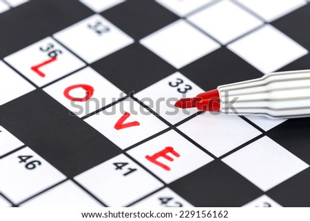 Close up red marker on Crossword - Love - stock photo