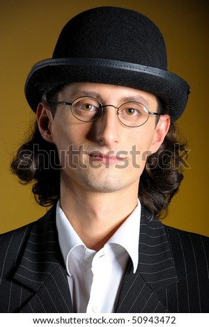 Close up retro portrait of young english gentleman in bowler hat and retro glasses