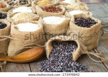 Close up rice berry in burlap bag - stock photo