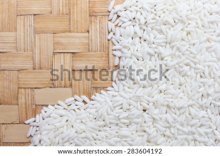 Close up rice grain on wooden basket. - stock photo