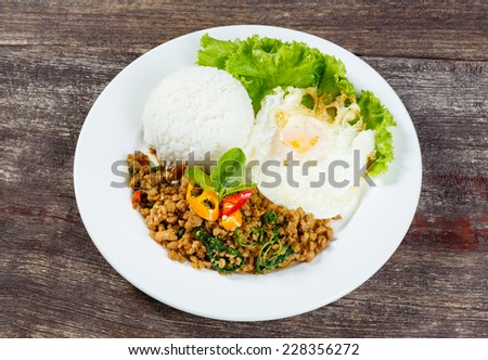 Close up Rice topped with stir fried minced pork and basil - stock photo