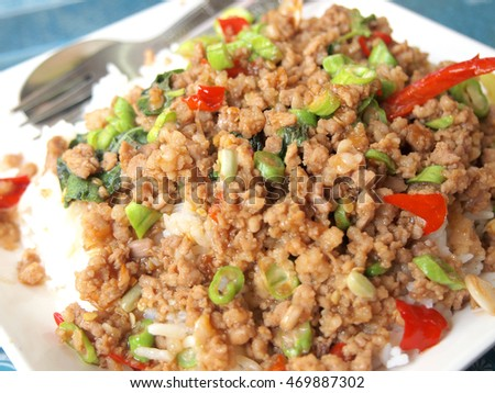 Close up Rice topped with stir fried pork and basil