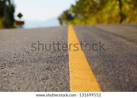 Close up road divide yellow line - stock photo