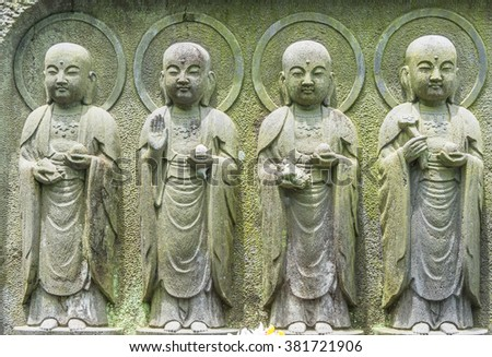 Close-up  row of stone Jizo Bodhisattva statues in the Hase-dera temple in Kamakura, Japan. - stock photo