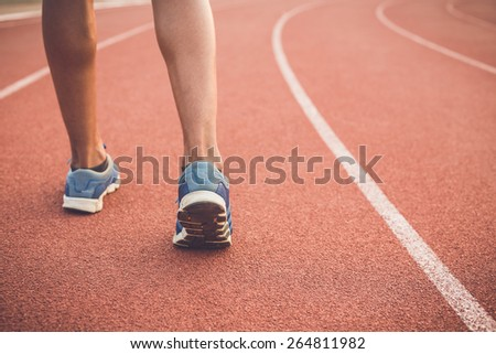 Close up runner feet on running stadium