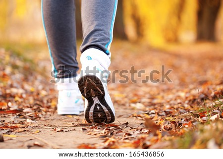 Close-up running feet outdoors. Healthy lifestyle, fitness, jogging, active, young concept. - stock photo