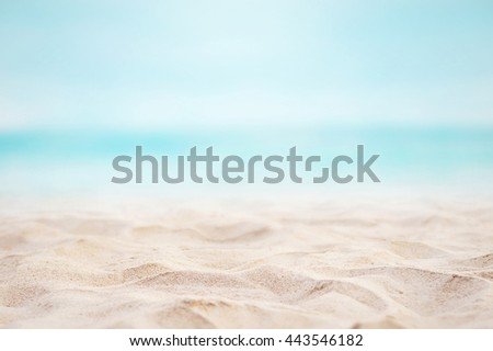 Close up sand with blurred sea sky background, summer day, copy space or for product. Summer background concept. - stock photo
