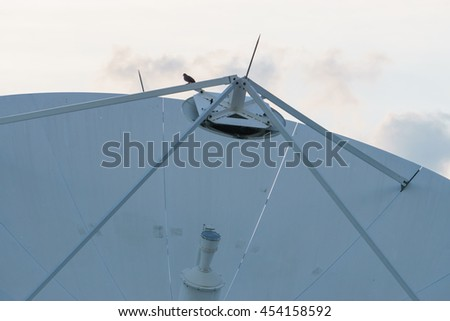 close up Satellite dishes line in bangkok with clouds in rainny day. - stock photo
