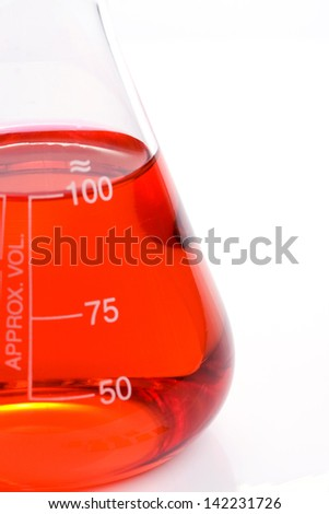 Close up scientific laboratory glass with red chemical liquid - stock photo