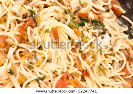 close up seafood spaghetti in a pan - stock photo