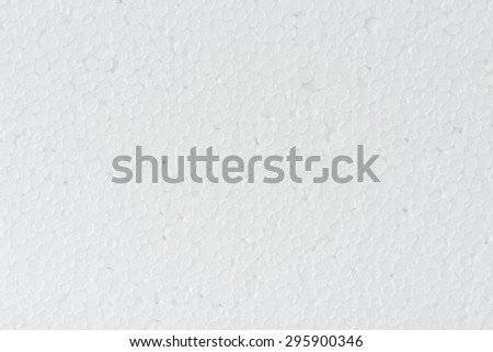 close up seamless background and texture of white foamed polystyrene sheet surface in closeup - stock photo