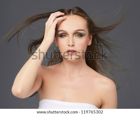 Close up Sensual pretty woman with beautiful long brown hairs - stock photo