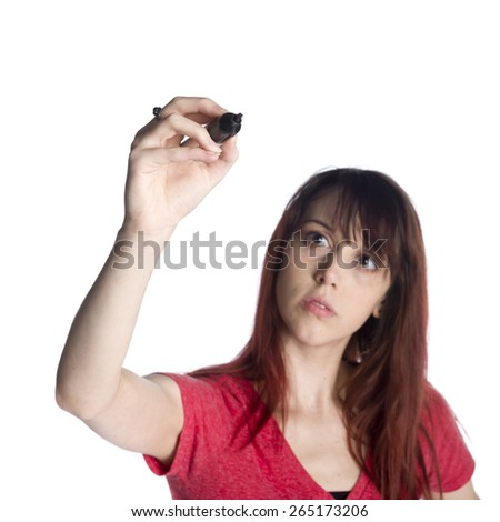 Close up Serious Young Woman in Red Shirt Holding a Black Marker Pen Up as if Writing Something, Isolated on White Background. - stock photo