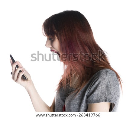 Close up Shocked Young Woman Facing at her Mobile Phone on her Hand with Wide Open Mouth, Isolated on White Background. - stock photo