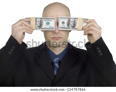 Close-up shot of a bald businessman covering his eyes with bundle of US dollar bundles. - stock photo