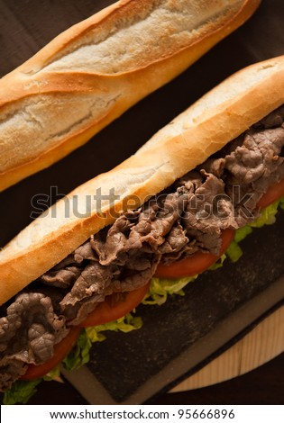 Close up shot of a beef meat sandwich. Low key image. - stock photo